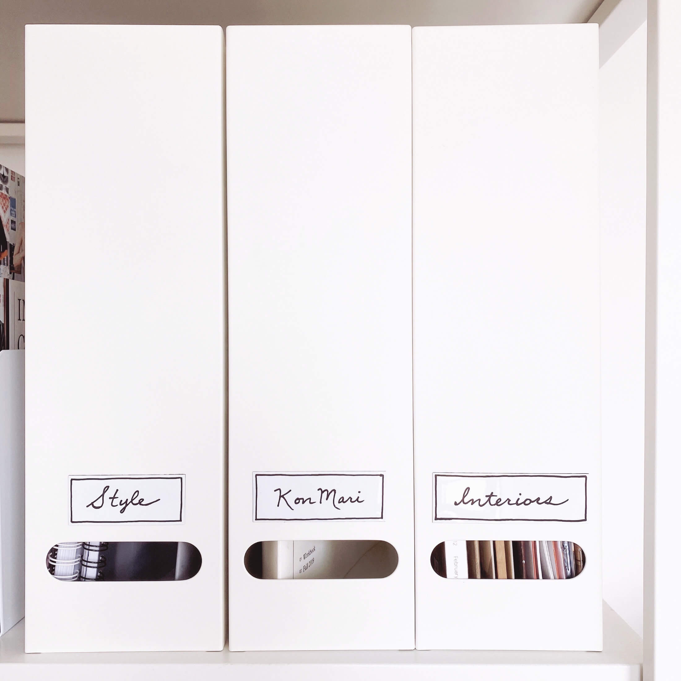 KonMari Tidying - Category Three: Papers. Neat White Metal Filing Boxes On Shelves, Labelled: Style, KonMari & Interiors.