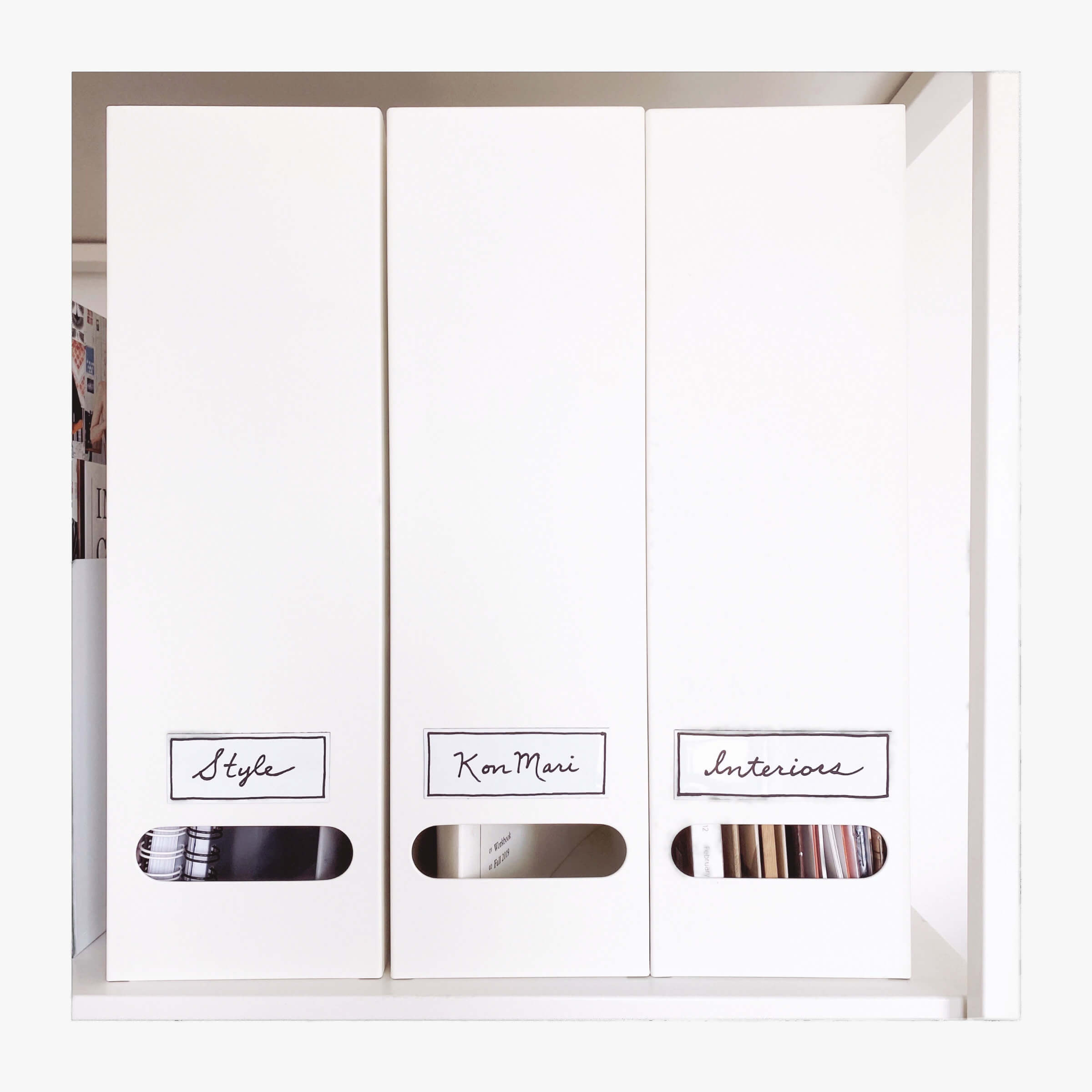 KonMari Tidying - Category Three: Papers. Tidy White Metal Filing Boxes On Shelves, Labelled: Style, KonMari & Interiors.