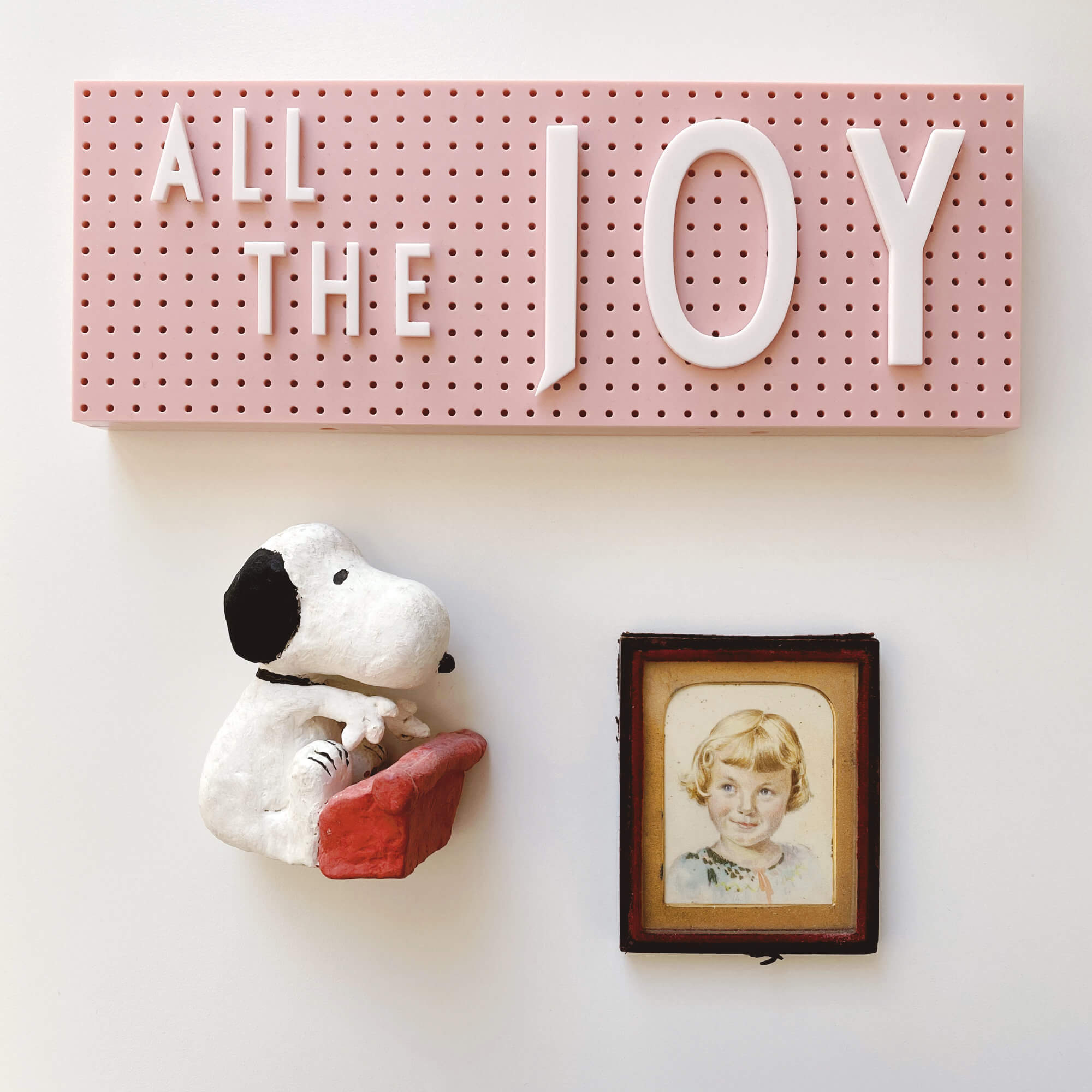 Sentimental Items Are Often Objects Made Long Ago, Like This Sweet Clay Snoopy And Illustrated Portrait Of A Little Girl