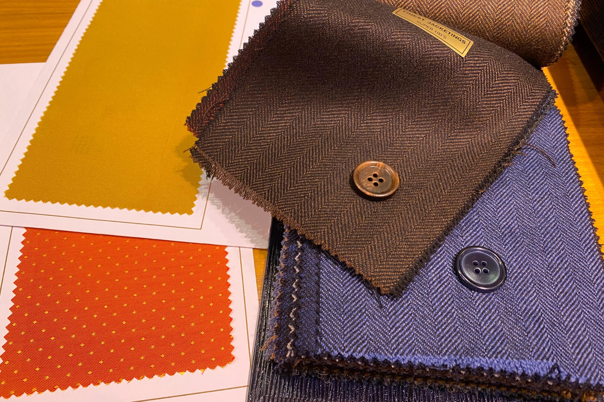 Browsing Through Luxurious Fabrics For Made-To-Measure Wedding Suits At Scabal On Savile Row