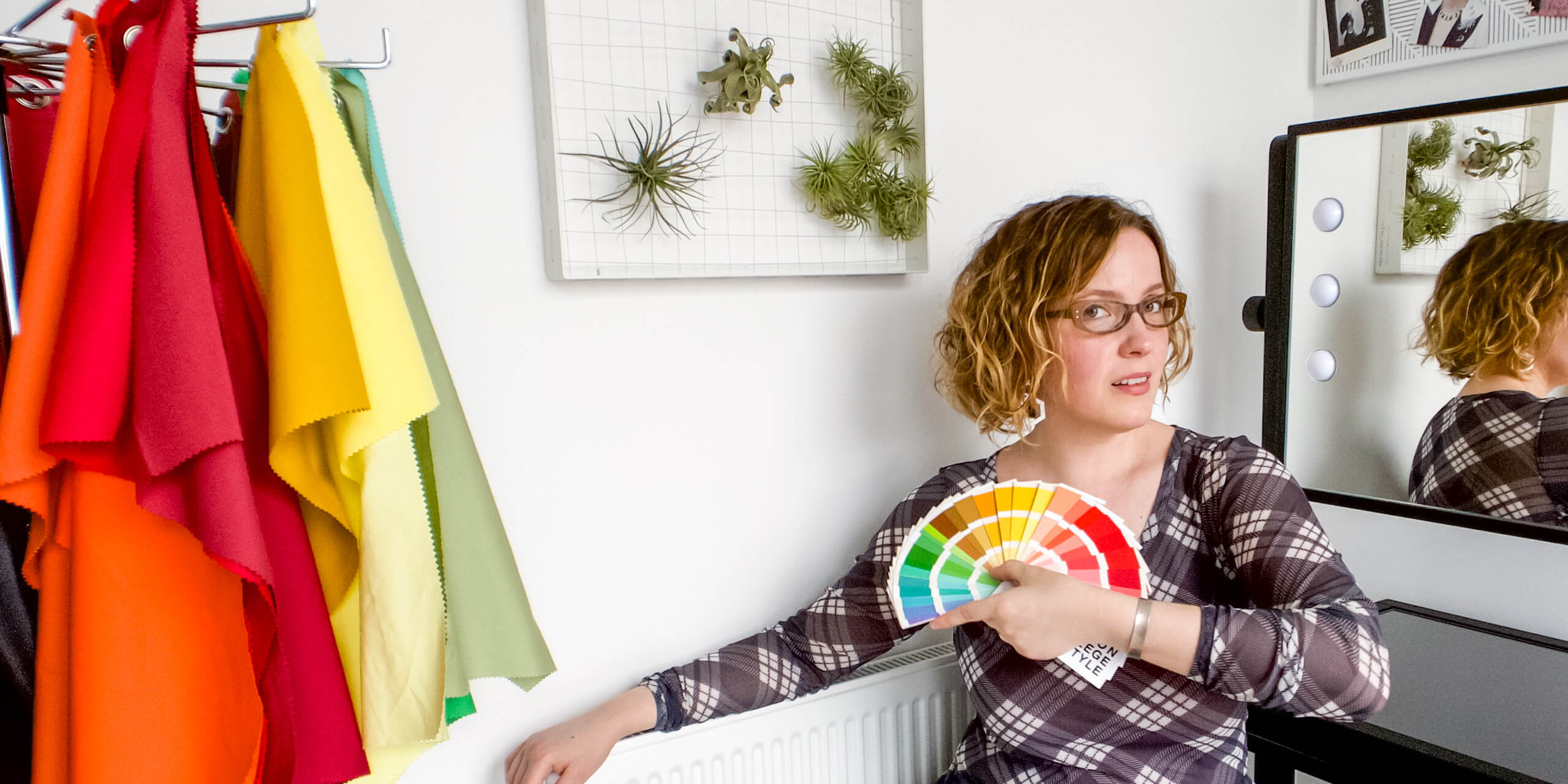 Alexandria Lawrence, Founder of ALSO in PINK. In Her Studio With Colour Analysis Drapes, Holding A Spring Colour Fan.