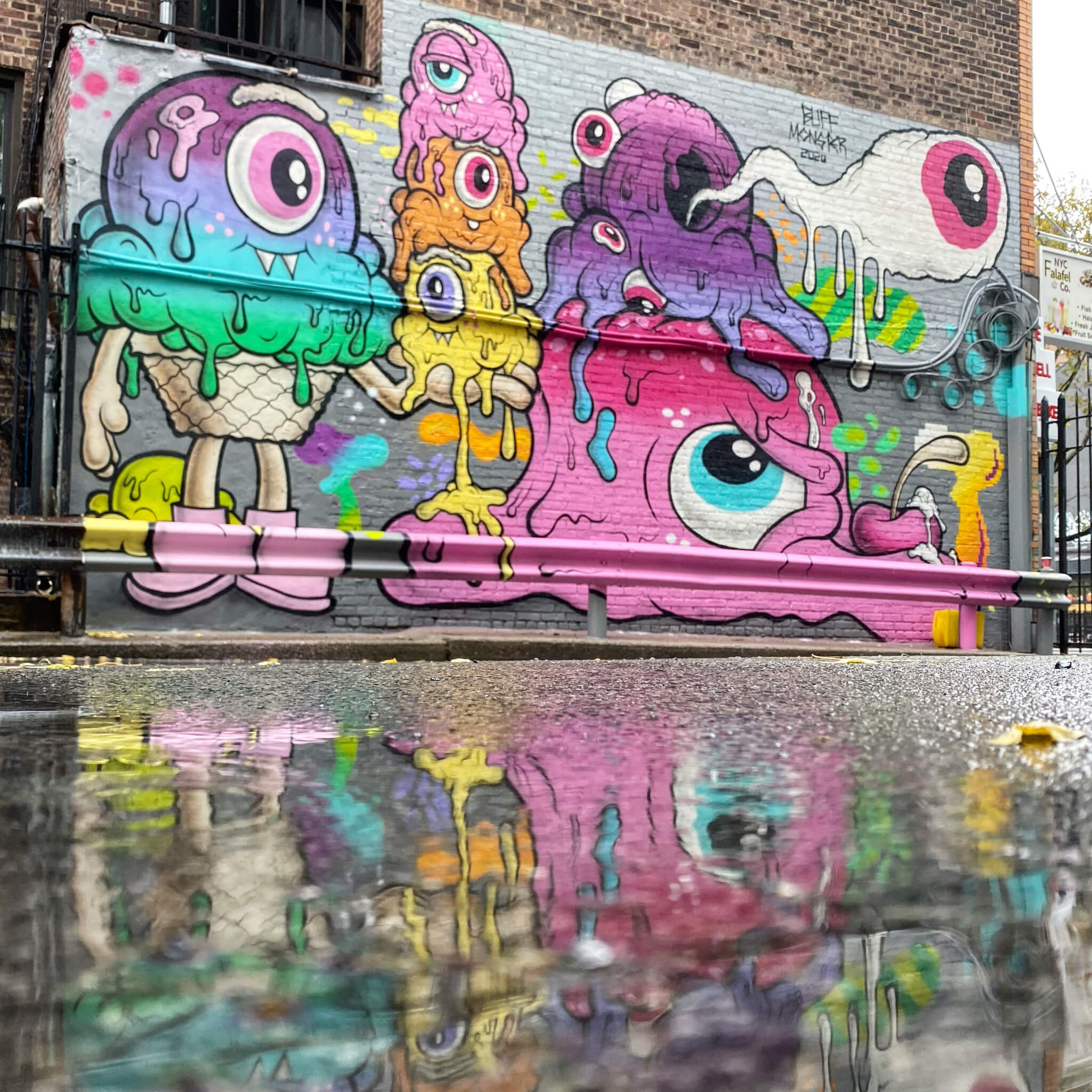 Colourful Street Art Photography by Sarah Sansom - Reflected in puddle