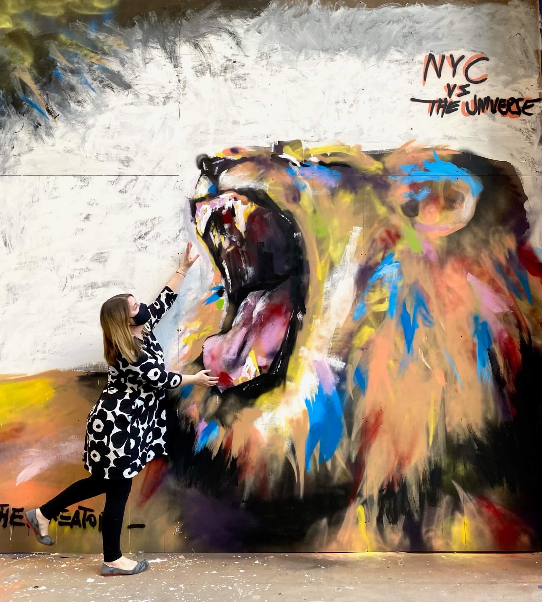 Street Art Photographer Sarah Sansom reaching into image of lion -