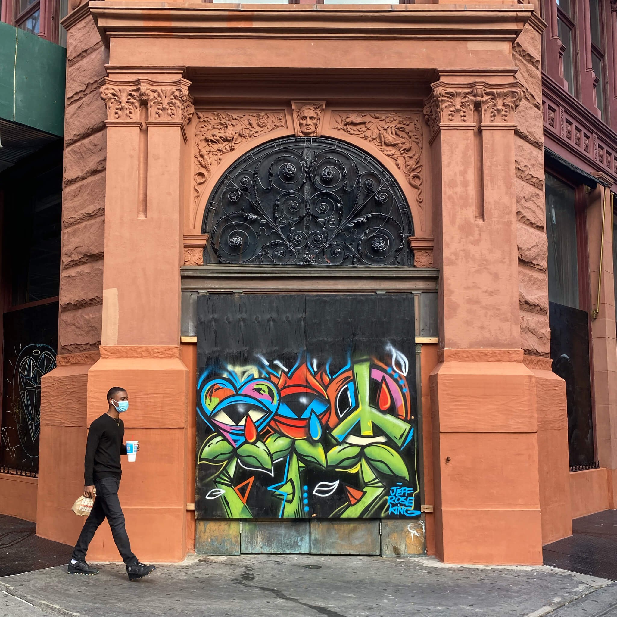 Stride by with man in mask Street Art Photography by Sarah Sansom