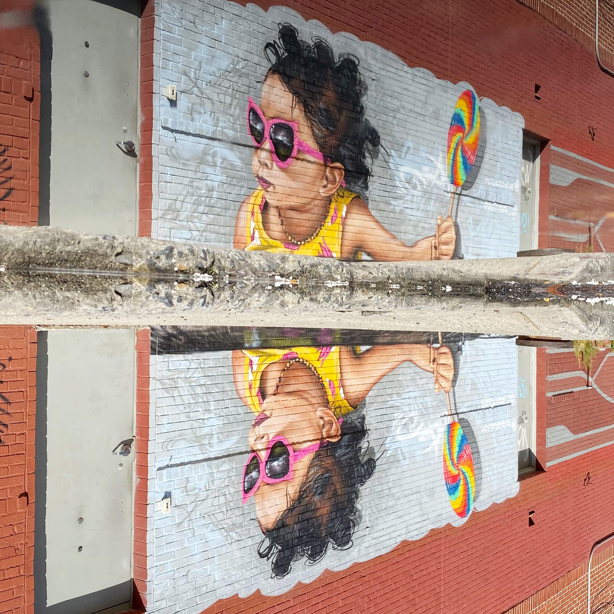 Reflection of Girl with Lollipop - Street Art Photography by Sarah Sansom