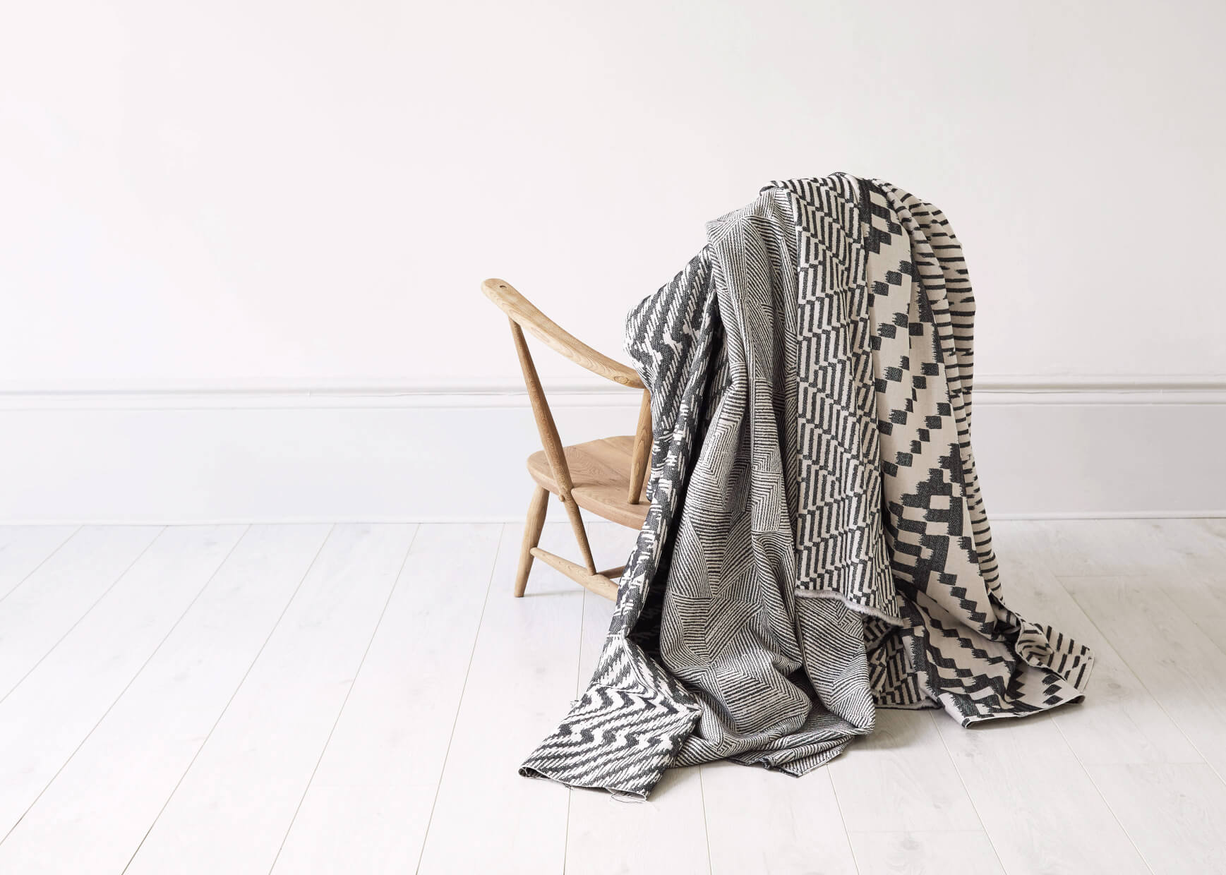 Beatrice Larkin Collection of Throws Draped over Ercol Chair