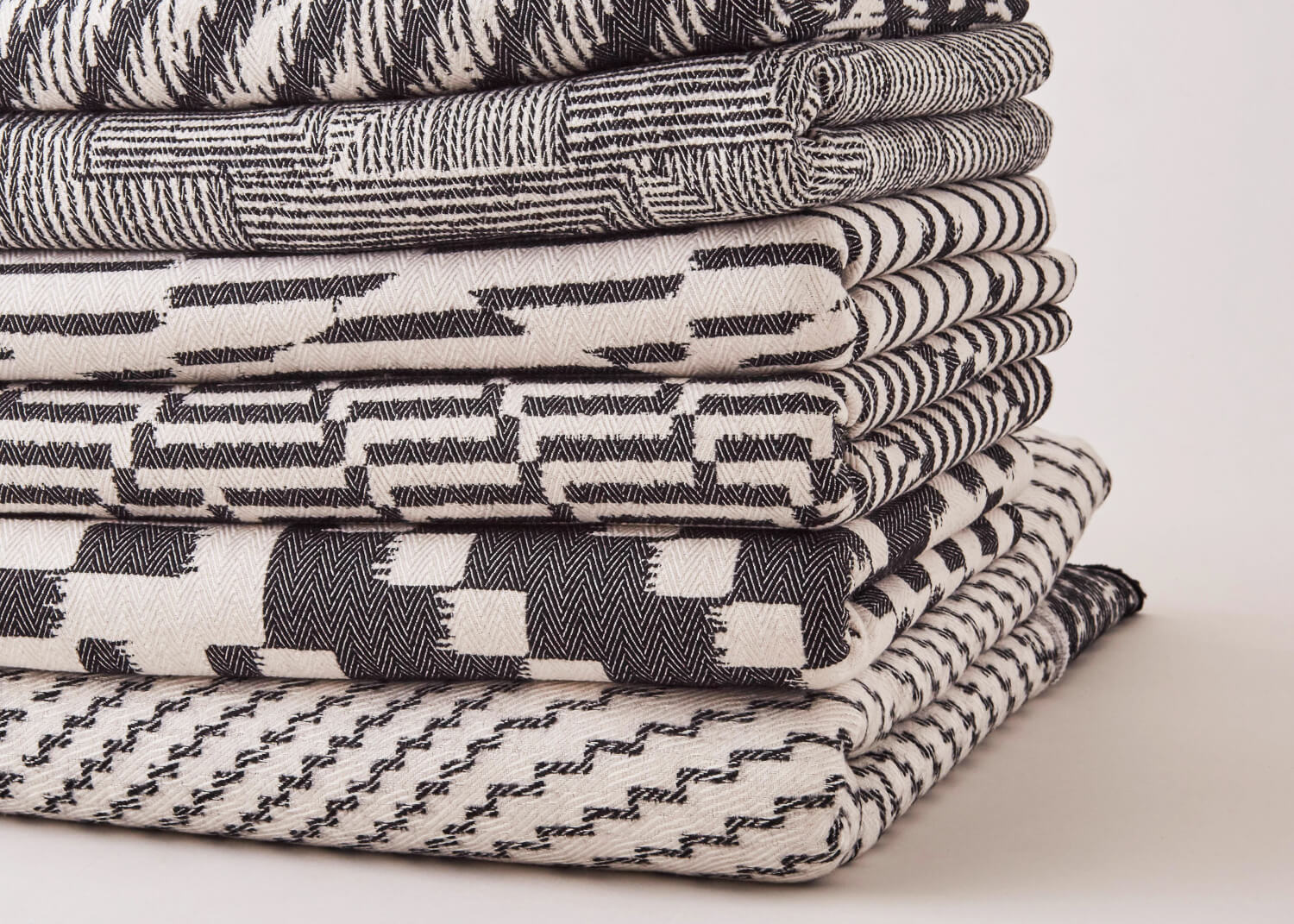 Beatrice Larkin Stack of Monochrome Throws in Gorgeous Graphic Patterns