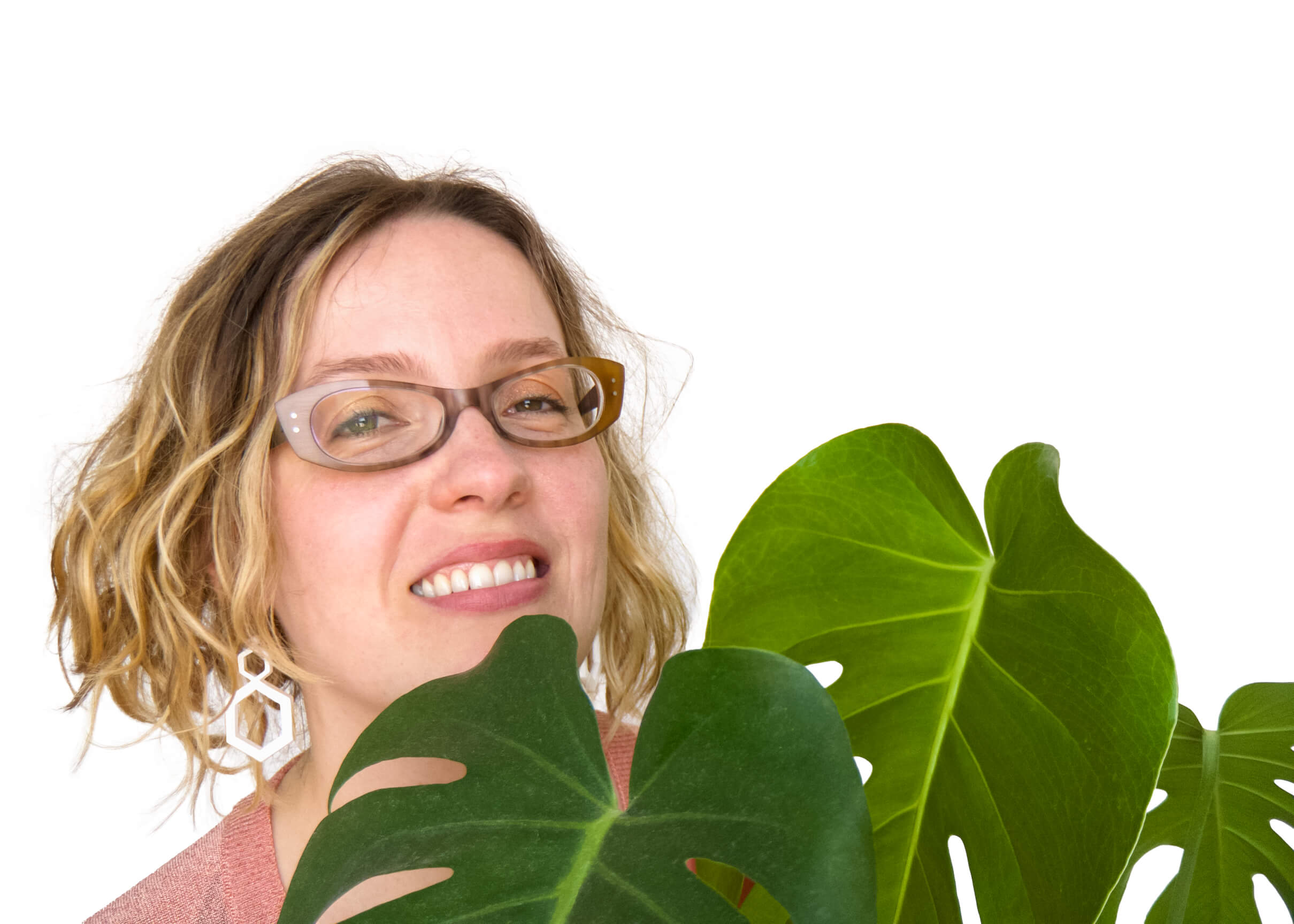 Alexandria Lawrence, Founder of ALSO in PINK. Smiling And Looking Full Of Joy Next To A Lovely Monstera Deliciosa