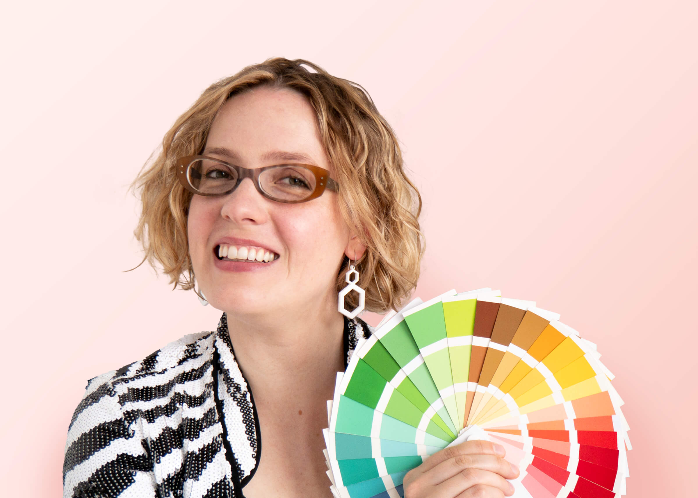 Alexandria Lawrence, Founder of ALSO in PINK. Podcast Cover Portrait Holding A Seasonal Spring Colour Fan