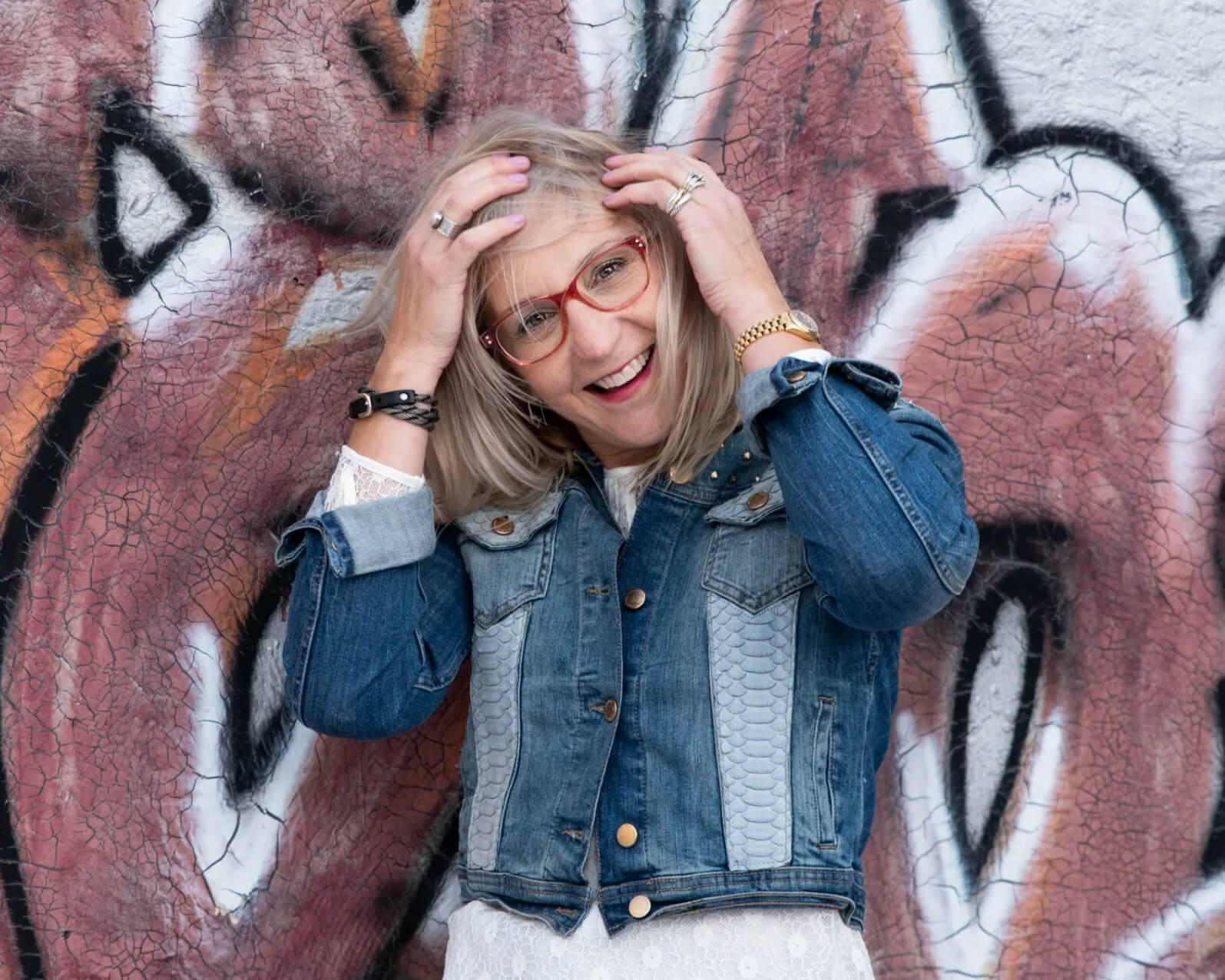 Personal stylist Kerry Cordero being a style rebel in front of a wall with some edgy street art