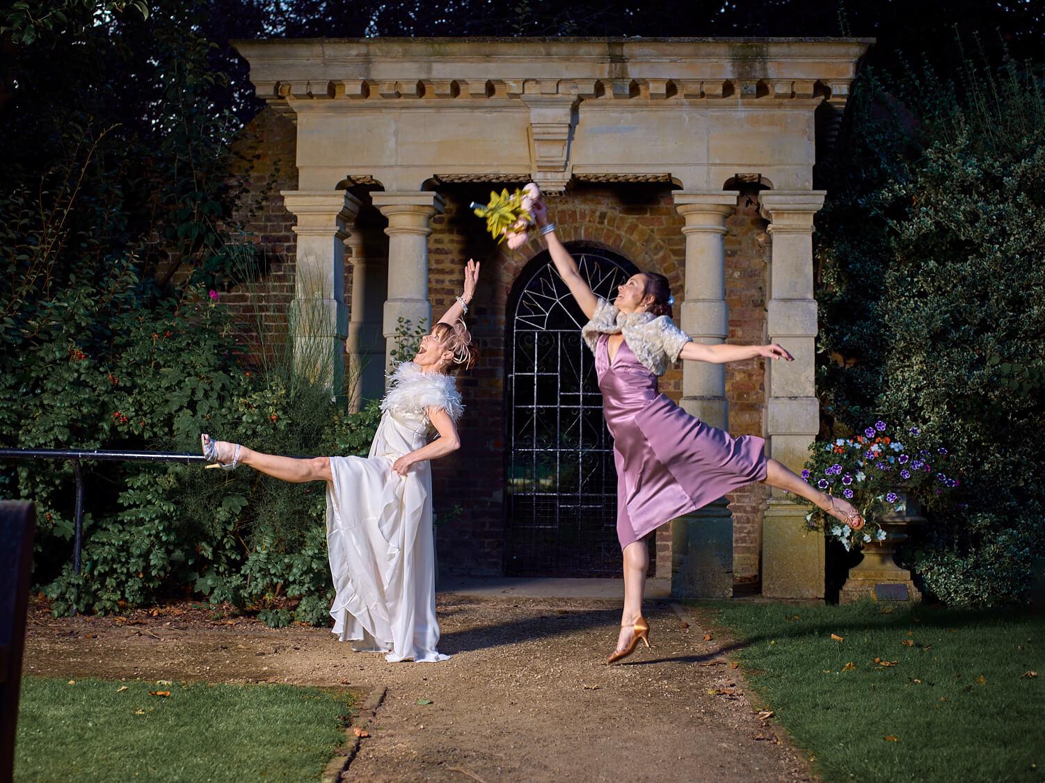 Heather Craig dancing in costume in a garden