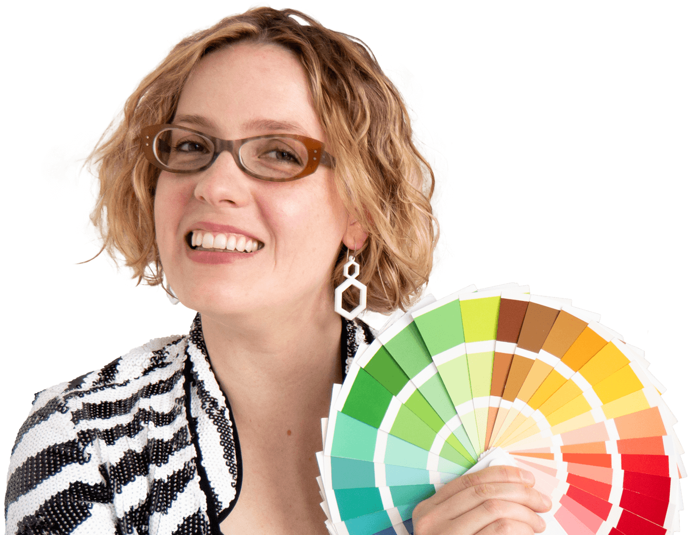 Alexandria Lawrence smiling, holding a seasonal colour fan and wearing a jazzy monochrome sequin jacket.
