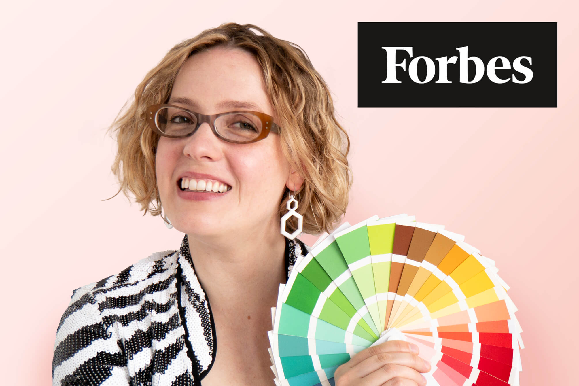 Alexandria Lawrence holding cheery spring colour fan, as featured on Forbes.