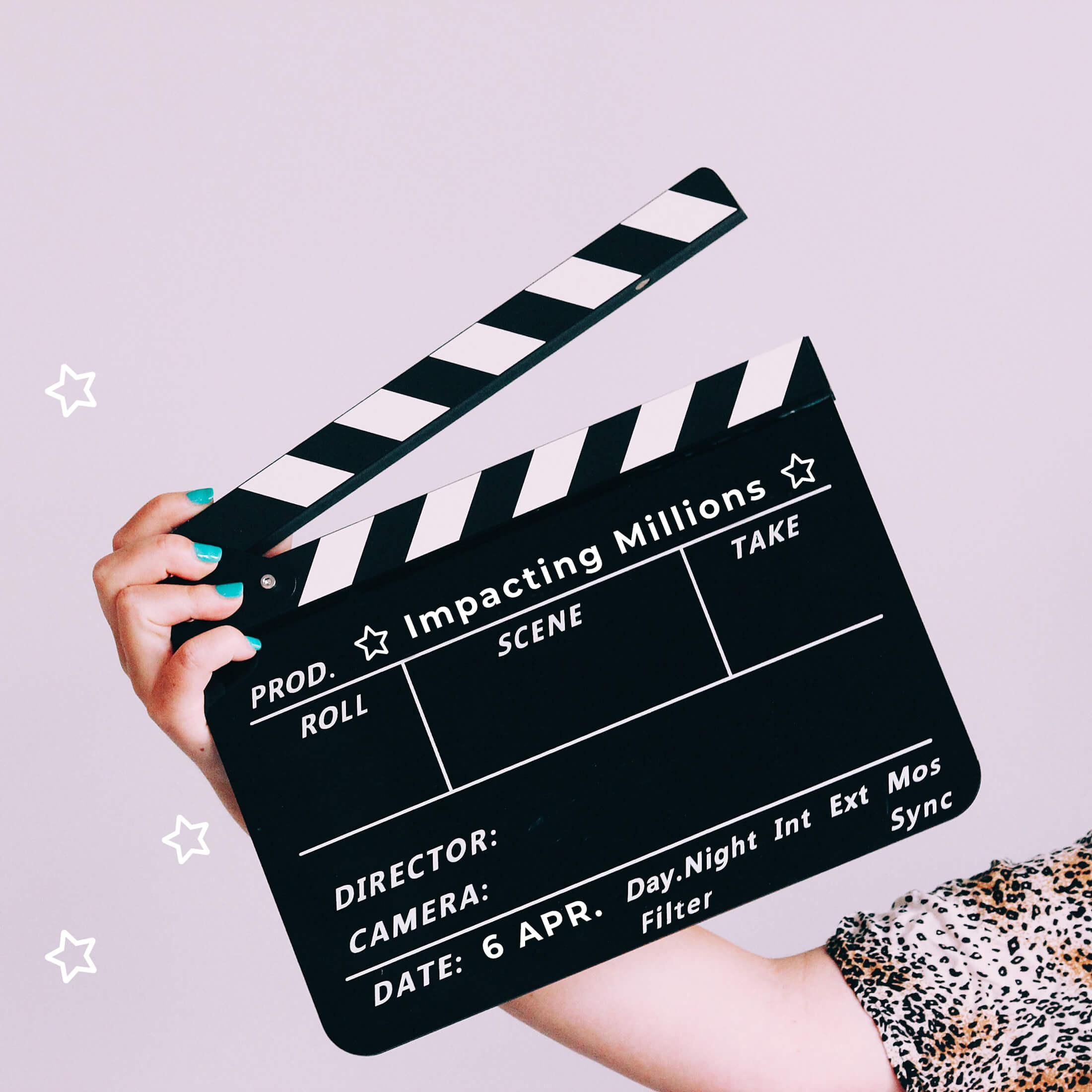 Clapperboard saying Impacting Millions with stars