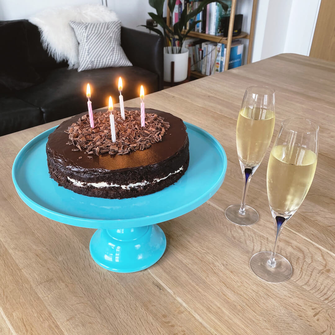 The Ottolenghi 40th birthday cake Ben made, plus two glasses of bubbly.