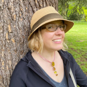 Alexandria Lawrence, standing against a tree, celebrating her 40th birthday at Kew Gardens
