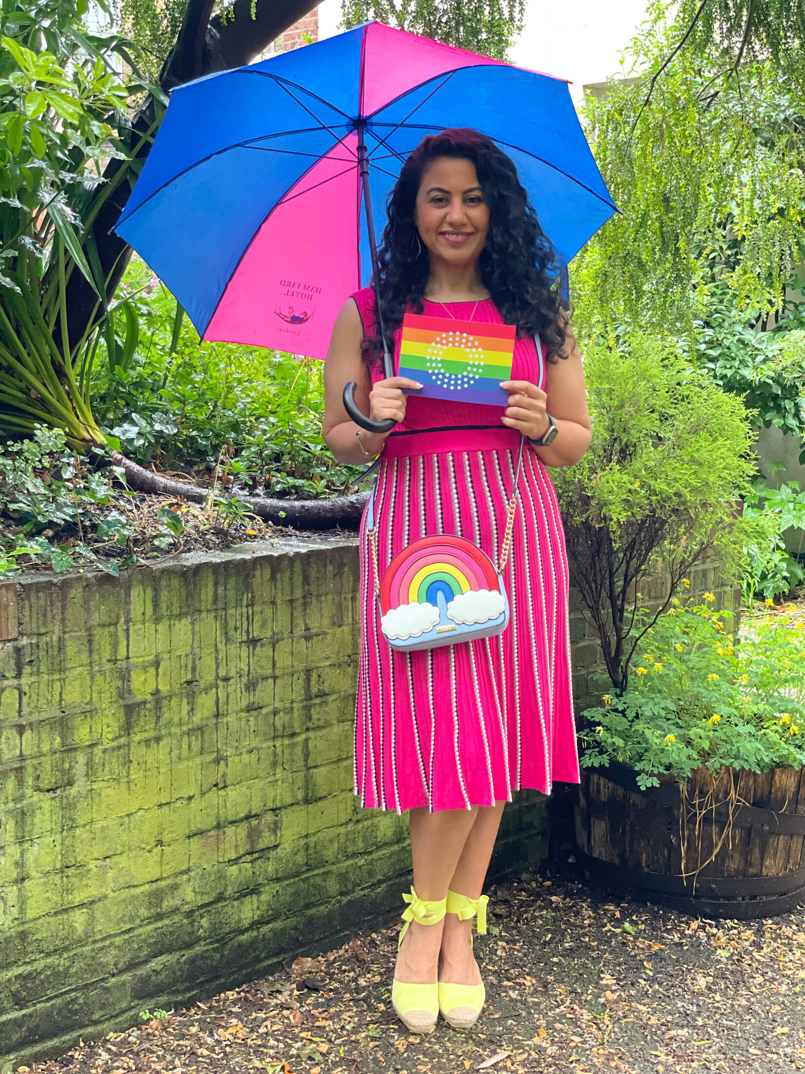 Lawyer Nada Jarnaz in a fabulous pink and rainbow outfit in honour of Pride Month
