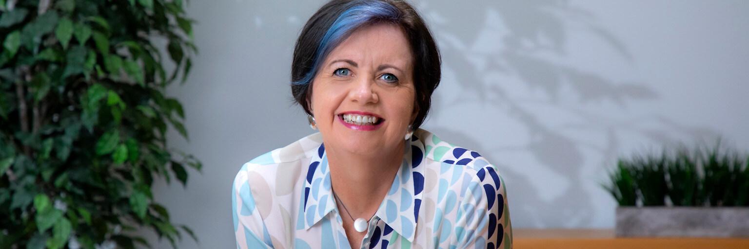 Leadership coach and comedic speaker Pam Dibbs, smiling